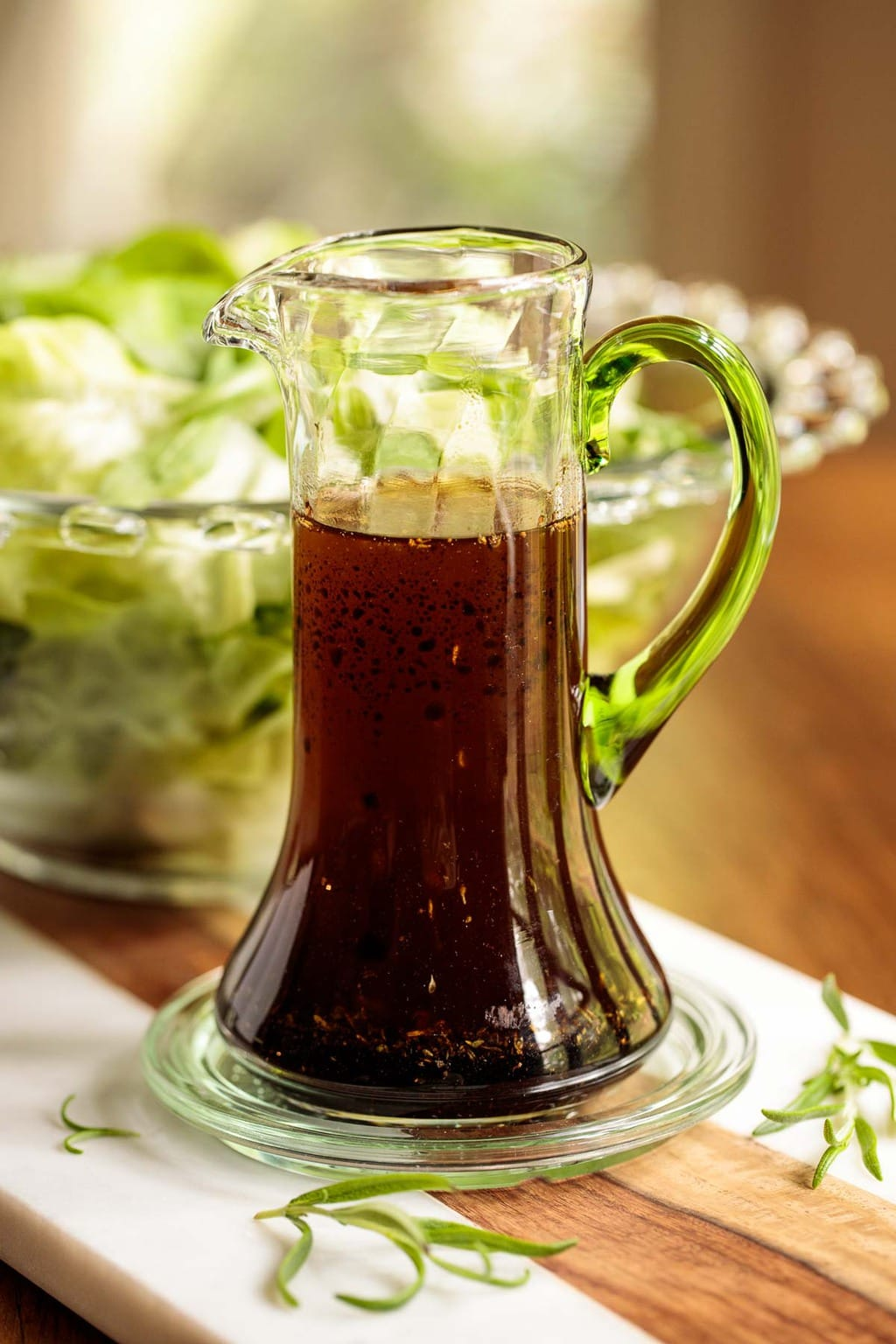 Vertical picture of Rosemary Balsamic Dressing in a glass cruet