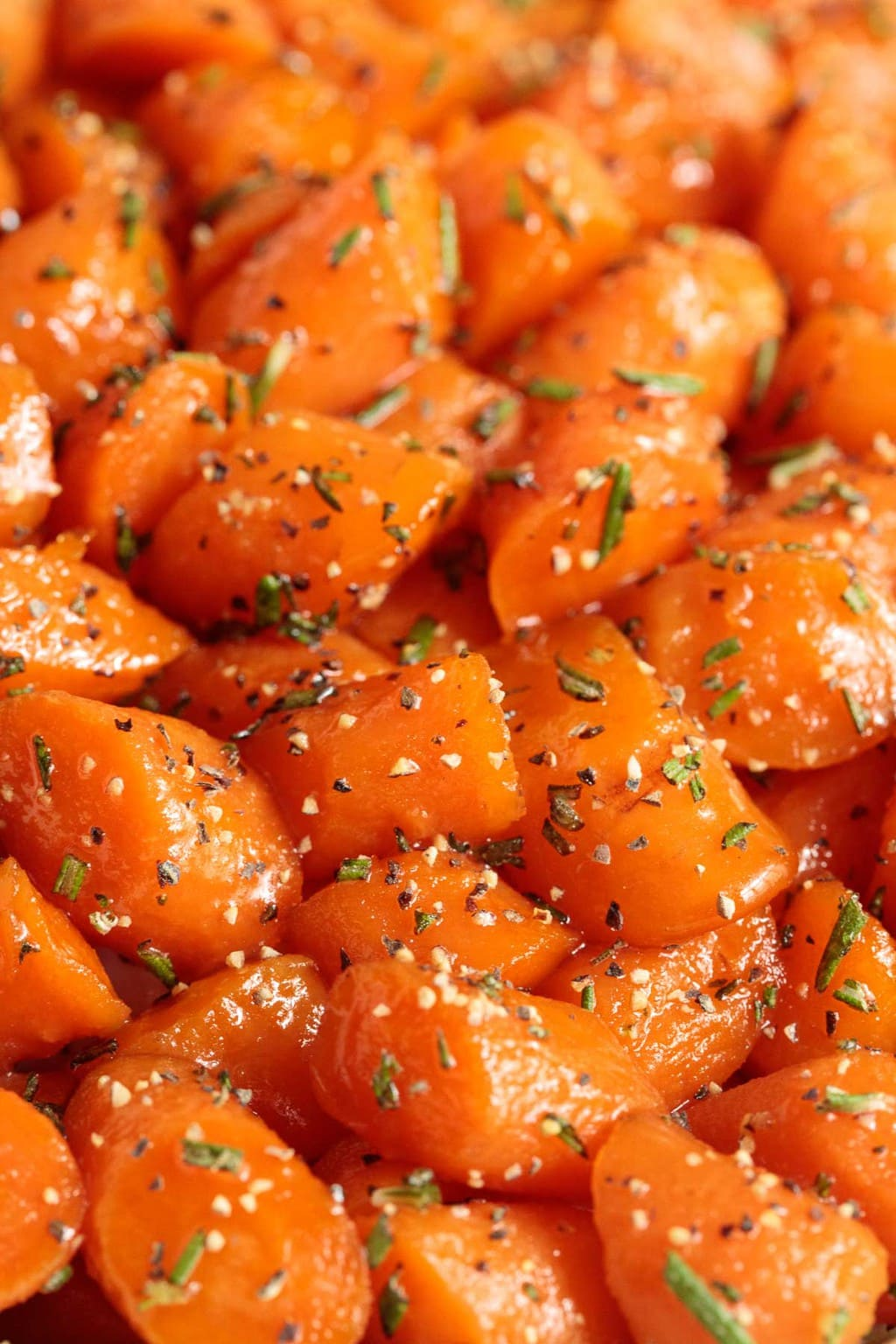 Extreme closeup photo of Rosemary Honey Glazed Carrots.