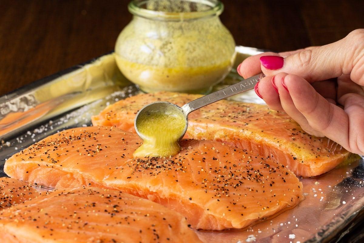 Closeup horizontal photo of the preparation for Israeli Couscous Salmon Salad using Lemon Dill Dressing.