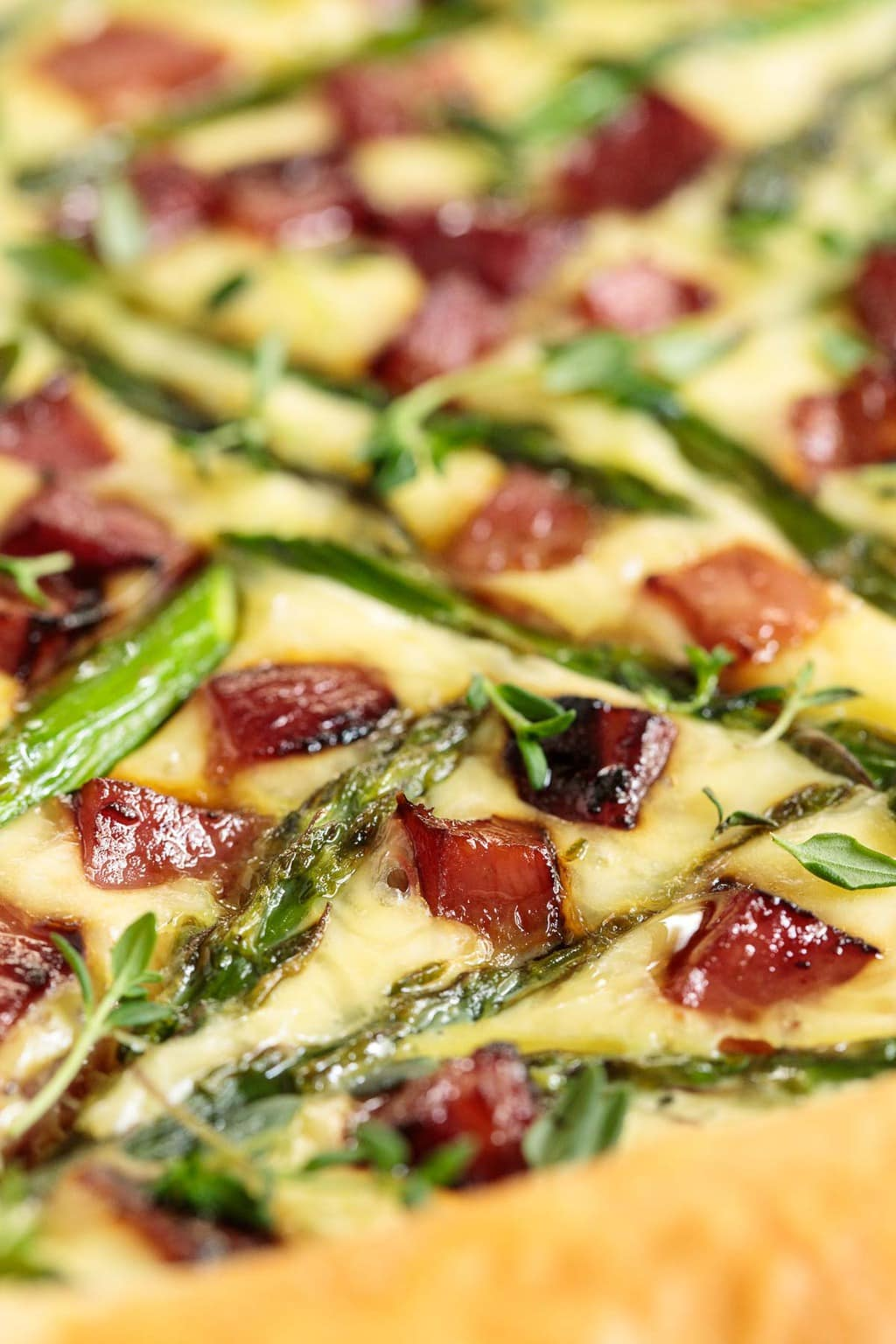 Extreme closeup of an Easy Savory Puff Pastry Tart with ham and asparagus.