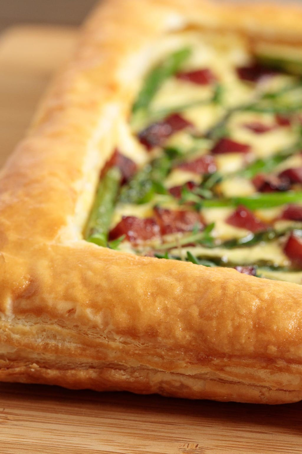 Extreme closeup of the crust of an Easy Savory Puff Pastry Tart.