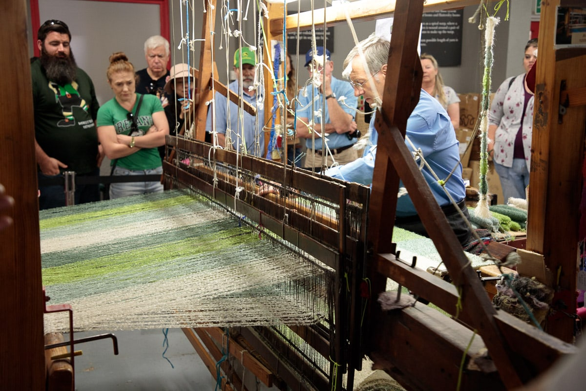 Photo of a demonstration of the original hand looms used at the Avoca Mill.