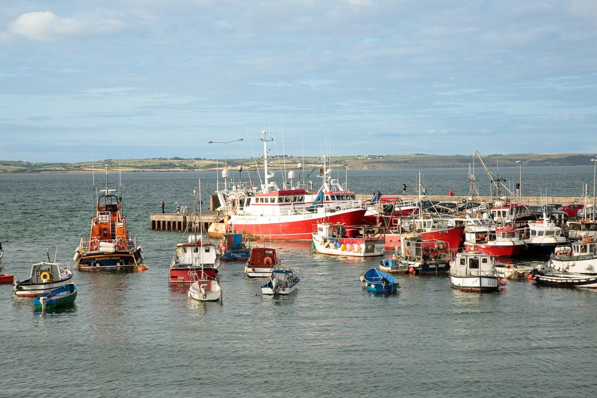 Photo of the docks and fishing ships in Ballycotton Bay, County Cork, Ireland.