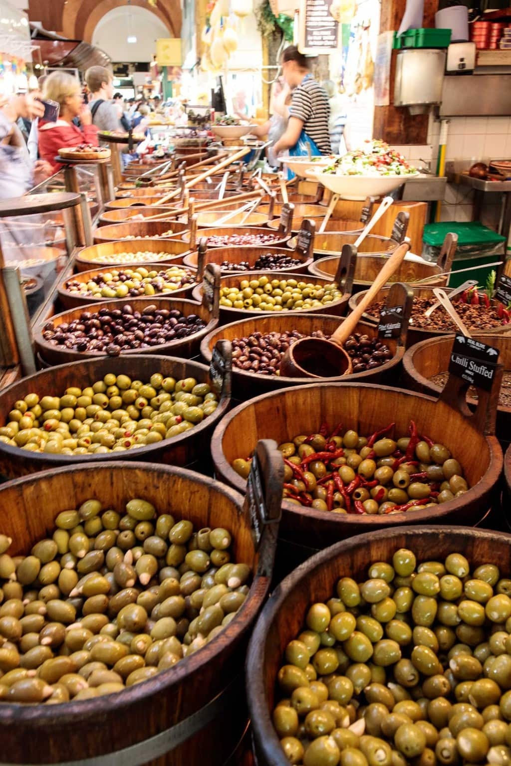 Photo of vendors displaying their olives at the English Market in Cork.