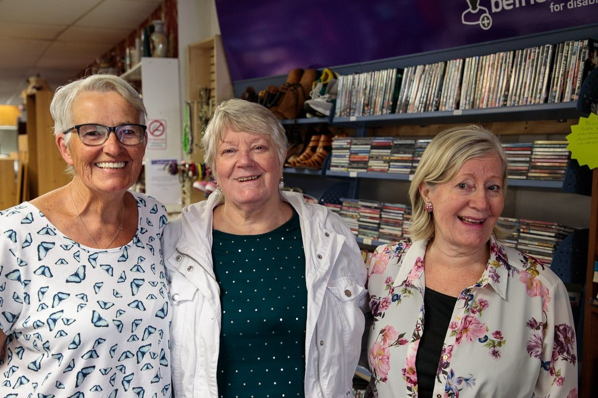 Photo of three volunteer workers at a charity shop in Whiteabbey, near Belfast, Northern Ireland.
