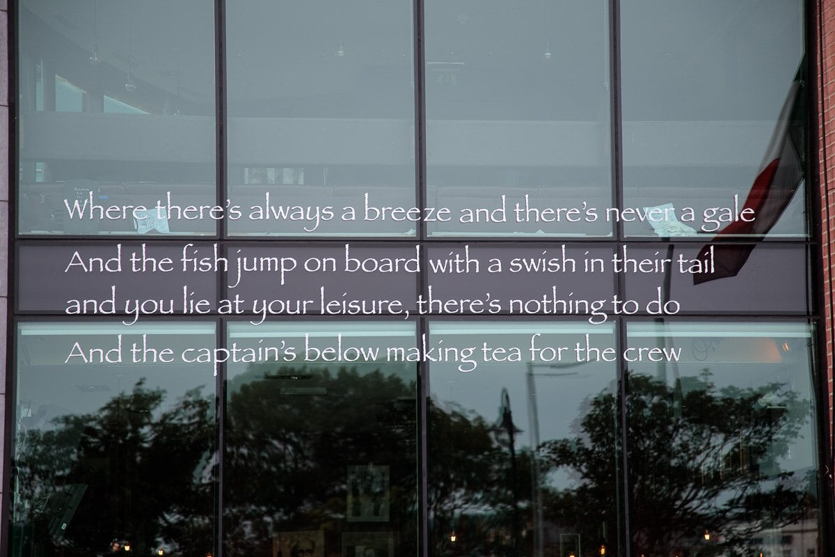 Photo of a poem on the window of one of the seaside seafood companies in Howth.