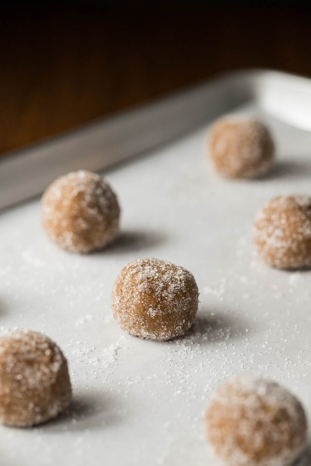 Photo of a baking pan full of Sea Salted Brown Sugar Cookie dough balls before baking.