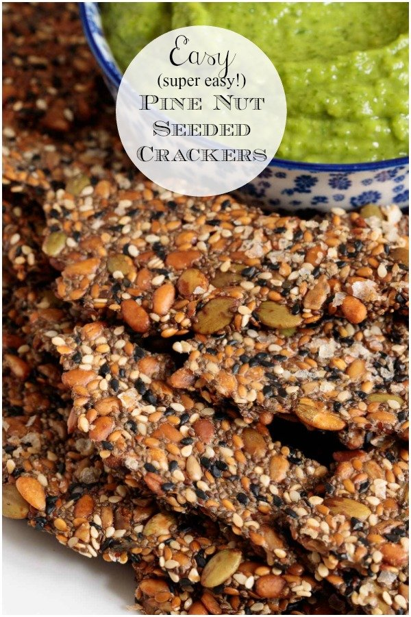 With 10 minutes of hands-on time, these super healthy, gluten-free Pine Nut Seeded Crackers are perfect for dips, snacking and alongside soups and salads! #seededcrackers, #healthsnack, #easycrackers, #glutenfree
