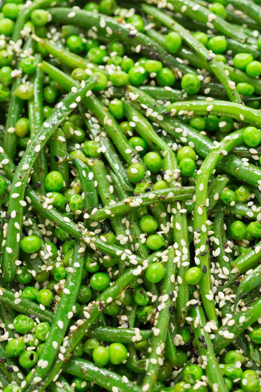 Ultra closeup photo of Sesame Ginger Green Bean Salad sprinkled with sesame seeds.