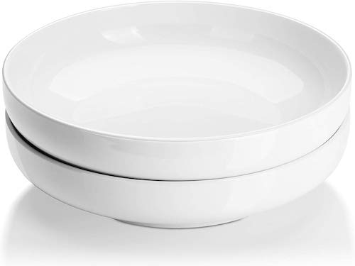 Stock photo of white salad bowls.