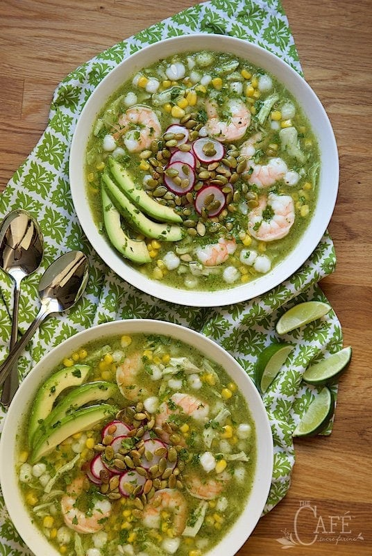 Overhead view of Shrimp and Chicken Pozole on a green cloth on a wooden table