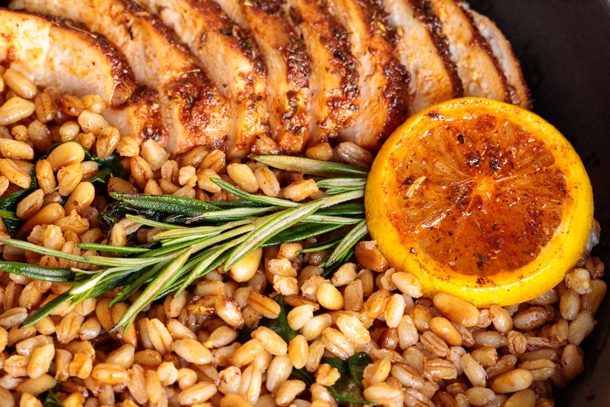 Closeup photo of Skillet Lemon Rosemary Chicken and Farro.
