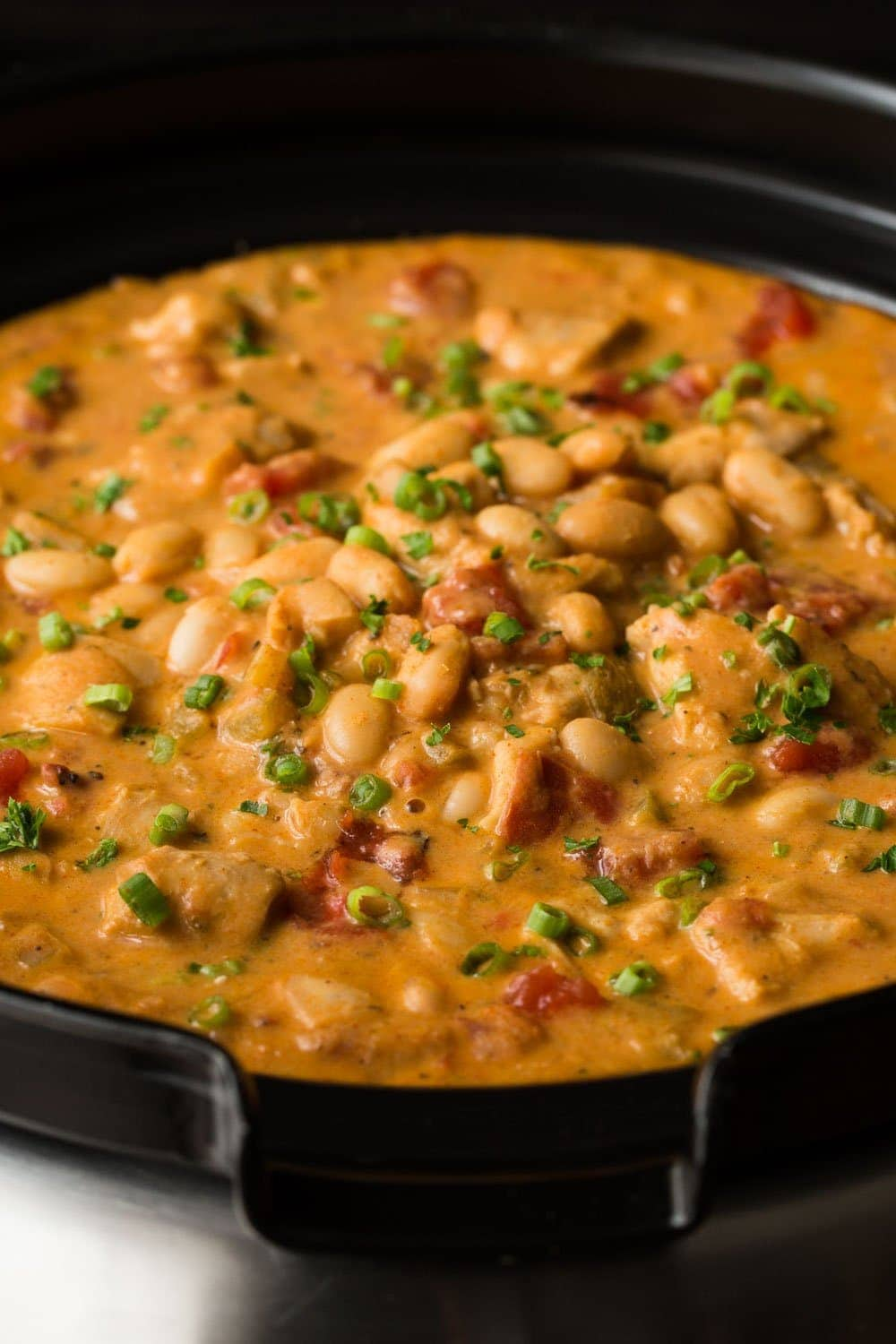 Slow Cooker Buffalo Chicken Chili - drawing on the flavor of classic Buffalo chicken wings, this chili is super easy, and loaded with delicious flavor! thecafesucrefarine.com