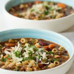 Vertical picture of Slow Cooker Pasta e Fagioli in white bowls