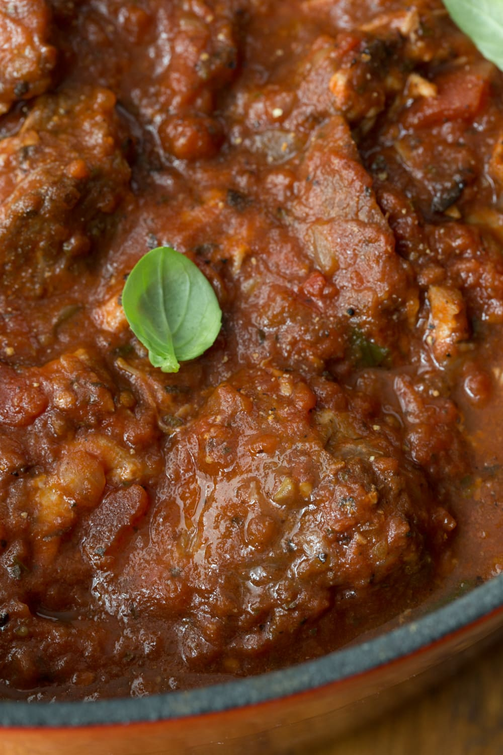 Slow Roasted Italian Pork - make-ahead, super tender and succulent pork in a thick, rich Italian tomato sauce. Who doesn't love Italian?