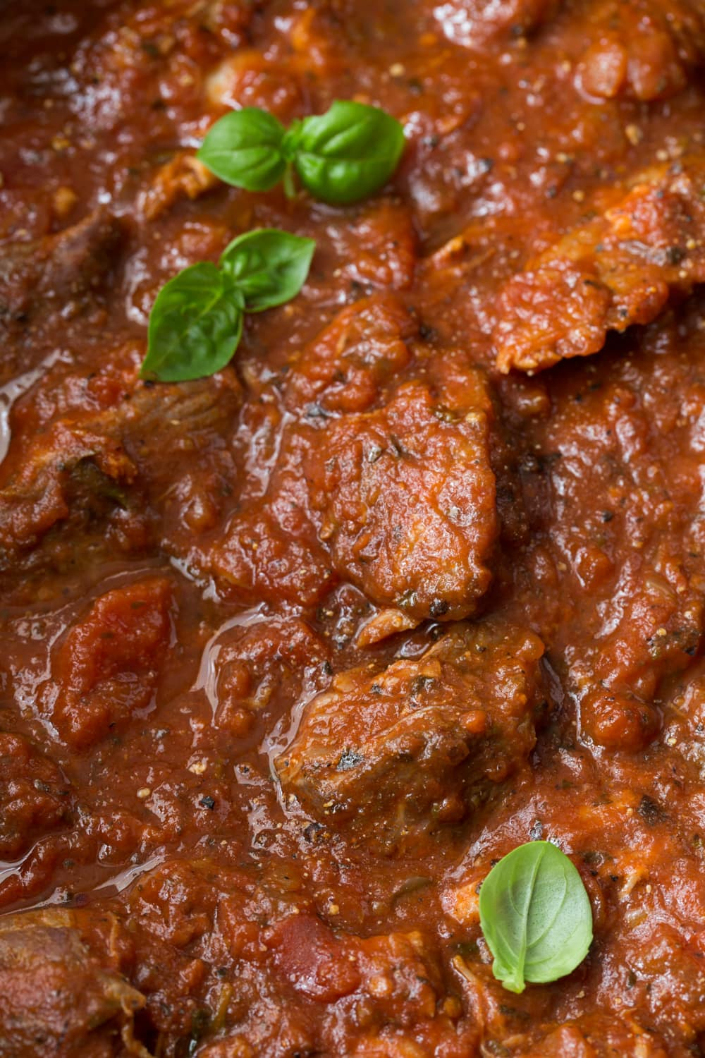 Slow Roasted Italian Pork - make-ahead, super tender and succulent pork in a thick, rich Italian tomato sauce.