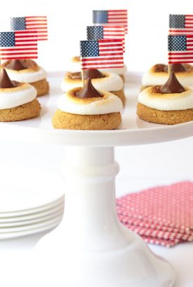 Vertical picture of S'mores Blossom Cookies on a white cakestand