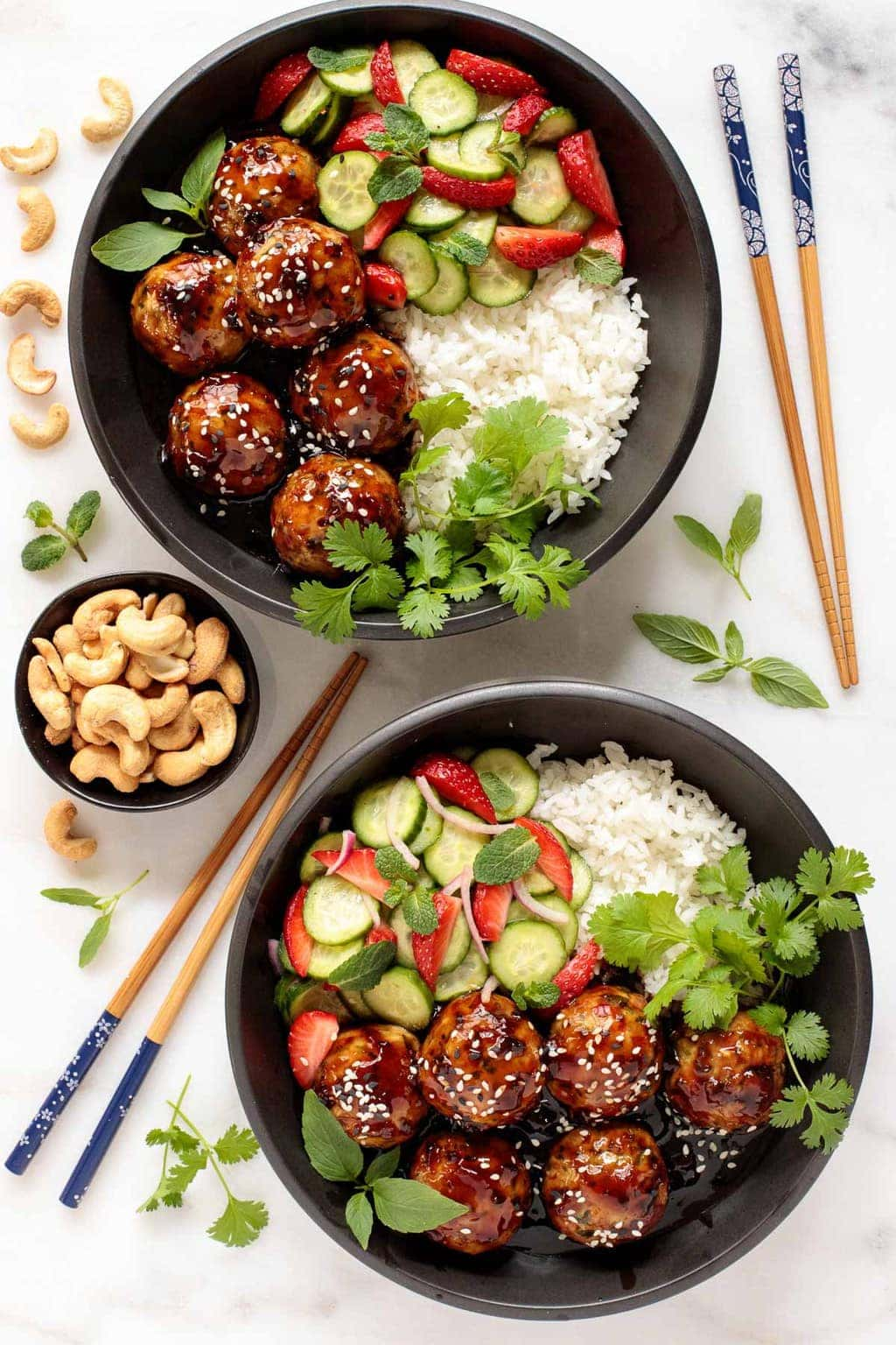 Overhead photo of two Strawberry Balsamic Chicken Meatball Rice Bowls.