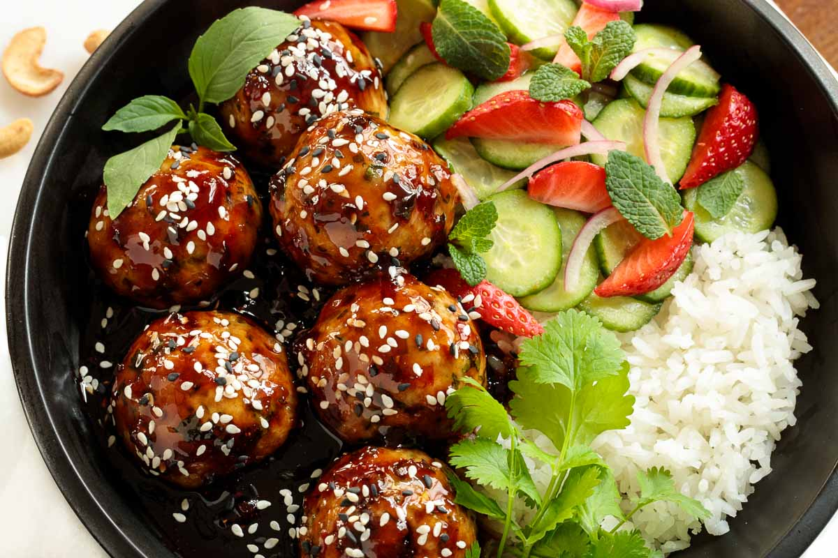 Overhead closeup photo of a Strawberry Balsamic Chicken Meatball Rice Bowl.