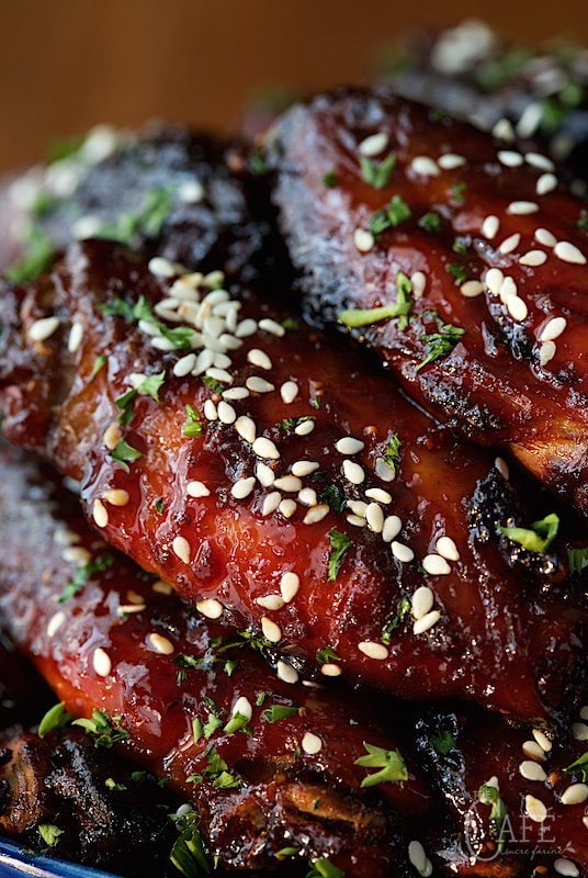Strawberry Balsamic Glazed Wings - just a warning; these are totally addictive! They're also baked, not fried and so EASY! thecafesucrefarine.com