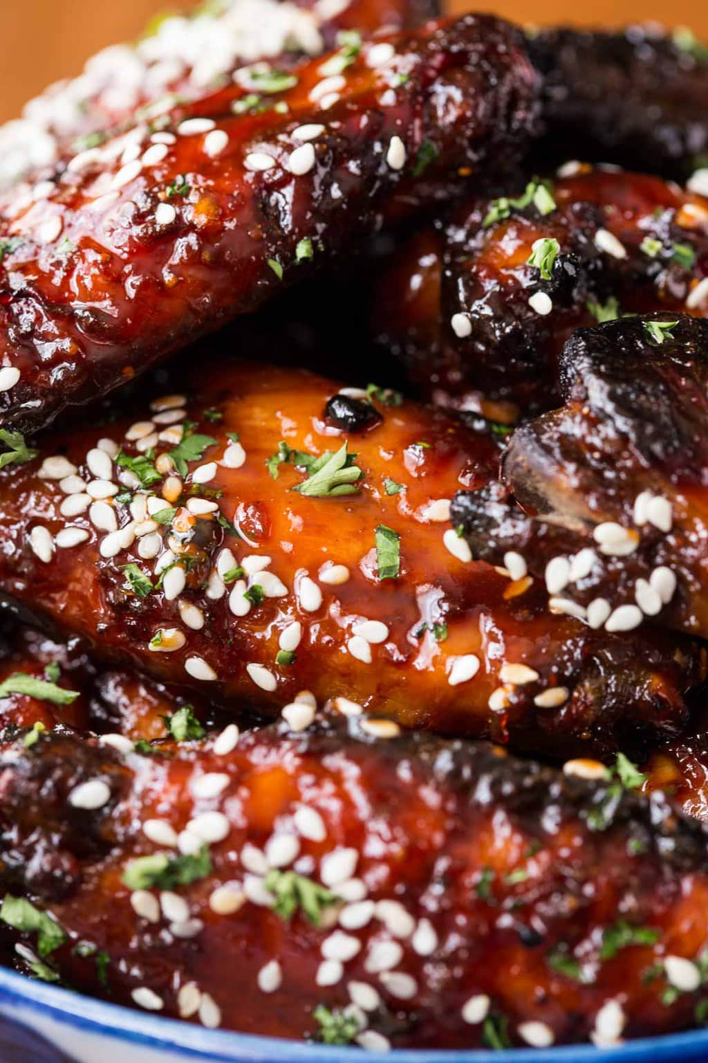 Closeup photo of a bowl of Strawberry Balsamic Baked Wings.