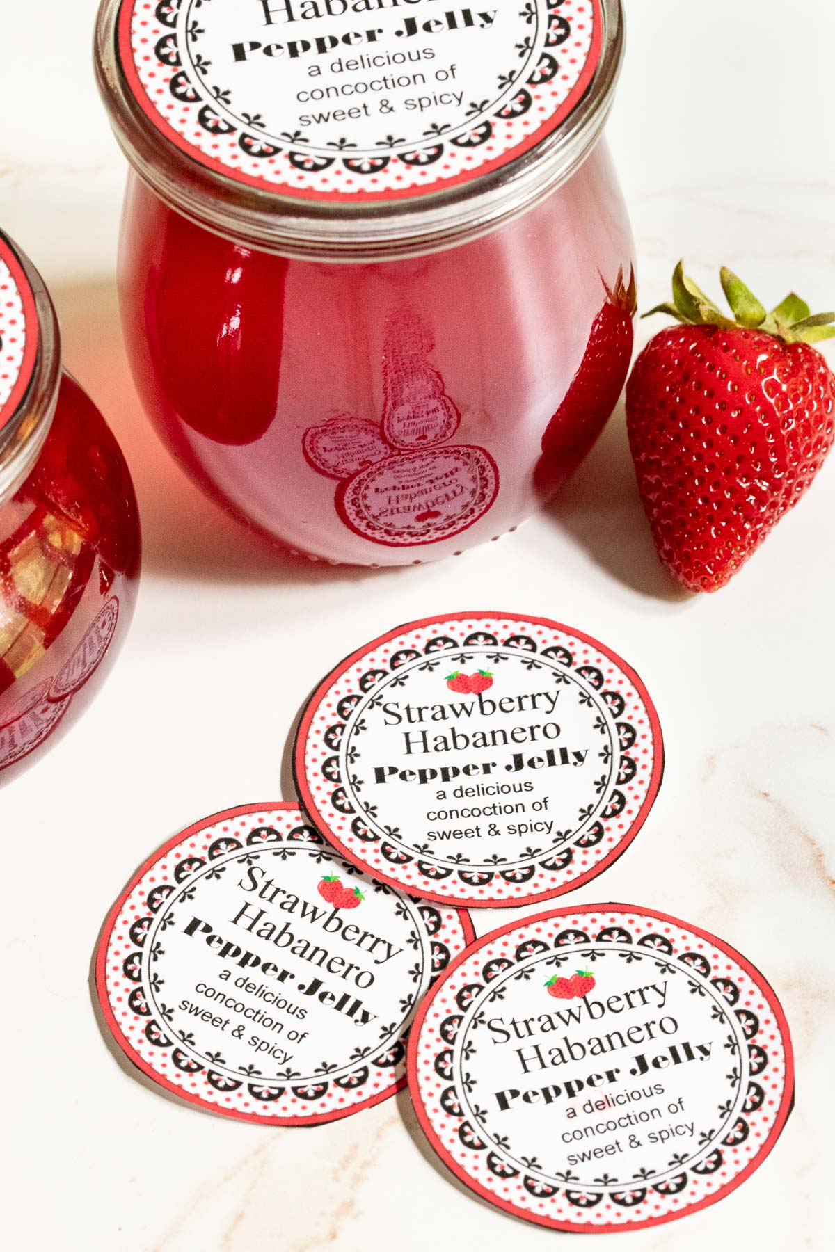 Vertical photo of Strawberry Habanero Pepper Jelly custom labels for gift giving.