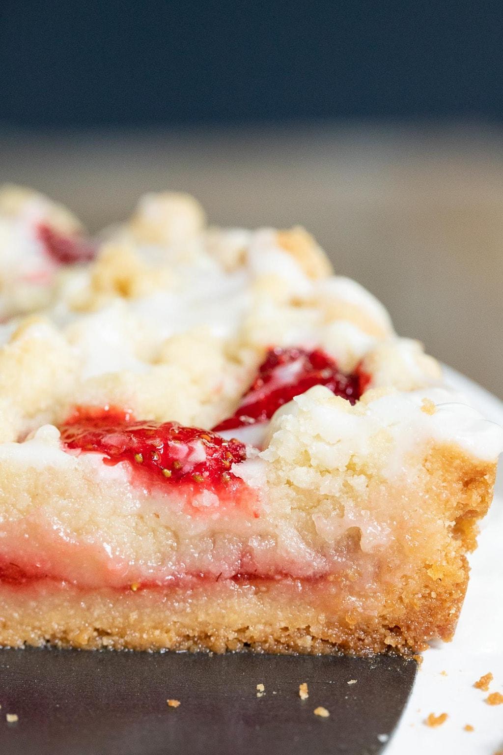 Ultra closeup photo of the inside of a Strawberry Jam Shortbread Tart.