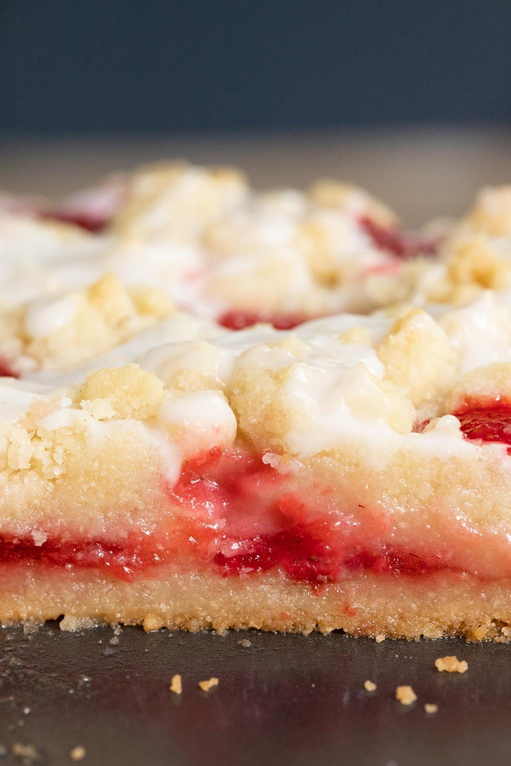 Ultra closeup vertical photo of the inside filling of a Strawberry Jam Shortbread Tart.