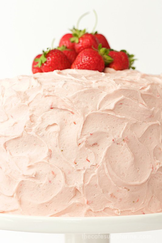 Strawberry Layer Cake - with layers of tender, moist yellow cake sandwiched between a double dose of strawberries - fresh strawberry buttercream and strawberry jam, this cake is the kind of confection that dreams are made of! thecafesucrefarine.com