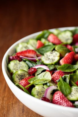 Vertical picture of Strawberry Spinach Salad in a white bowl