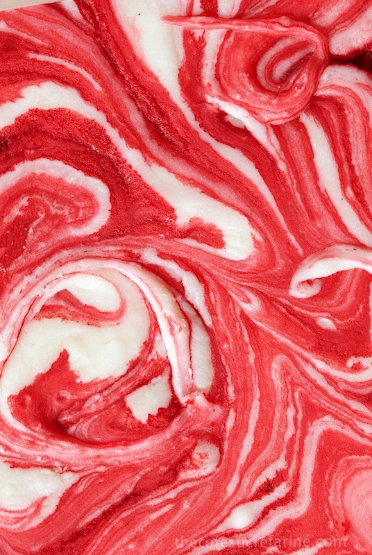 Strawberry Swirled Fantasy Fudge - totally mind blowing fudge! It's creamy with flecks of vanilla bean and swirled with strawberries. Makes a lovely gift if you can get it out of the house! It disappears right before my eyes when I make it!