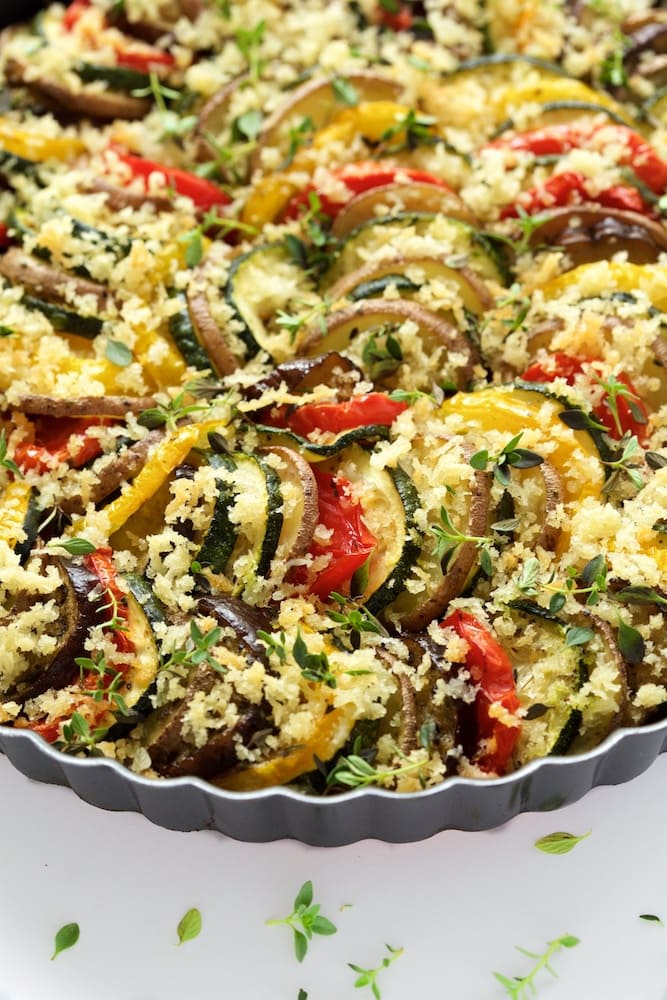 Summer Veggie Gratin - the summer's best produce layered, brushed with garlic oil, then baked to perfect tenderness. The grand finale? A crisp parmesan bread crumb topping with lots of fresh thyme! www.thecafesucrefarine.com