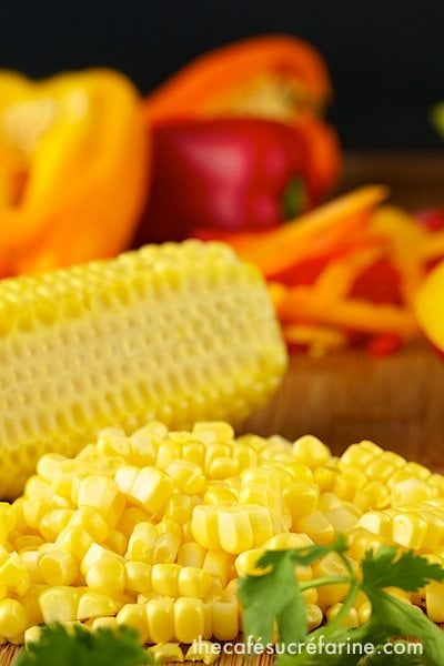 Closeup photo of fresh corn sliced off the cob and other ingredients for making Farmer's Market Salad.