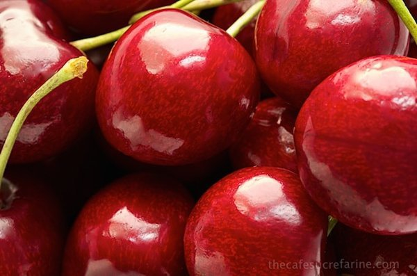 Ultra closeup photo of a pile of cherries
