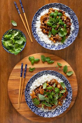 Overhead picture of Hoisin Cashew Chicken and rice in blue and white bowls