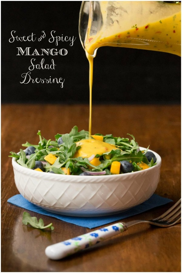 So delicious, super easy and this dressing is the anecdote for boring salads and it's fabulous drizzled over pan-seared or grilled salmon, shrimp or chicken! #easysaladdressing, #mangosaladdressing, #sweetandspicysaladdressing