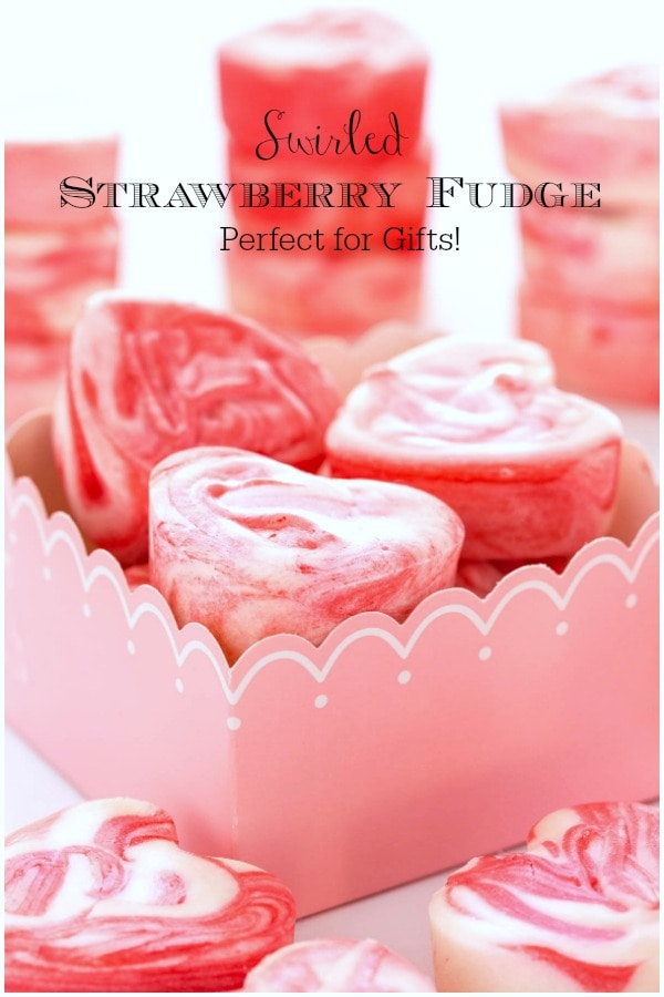 This Strawberry Swirled Fantasy Fudge is melt-in-your-mouth creamy with flecks of vanilla bean and delicious swirls of strawberry. It's perfect for gift-giving! #strawberryfudge, #easyfudge, #valentinefudge, #pinkfudge