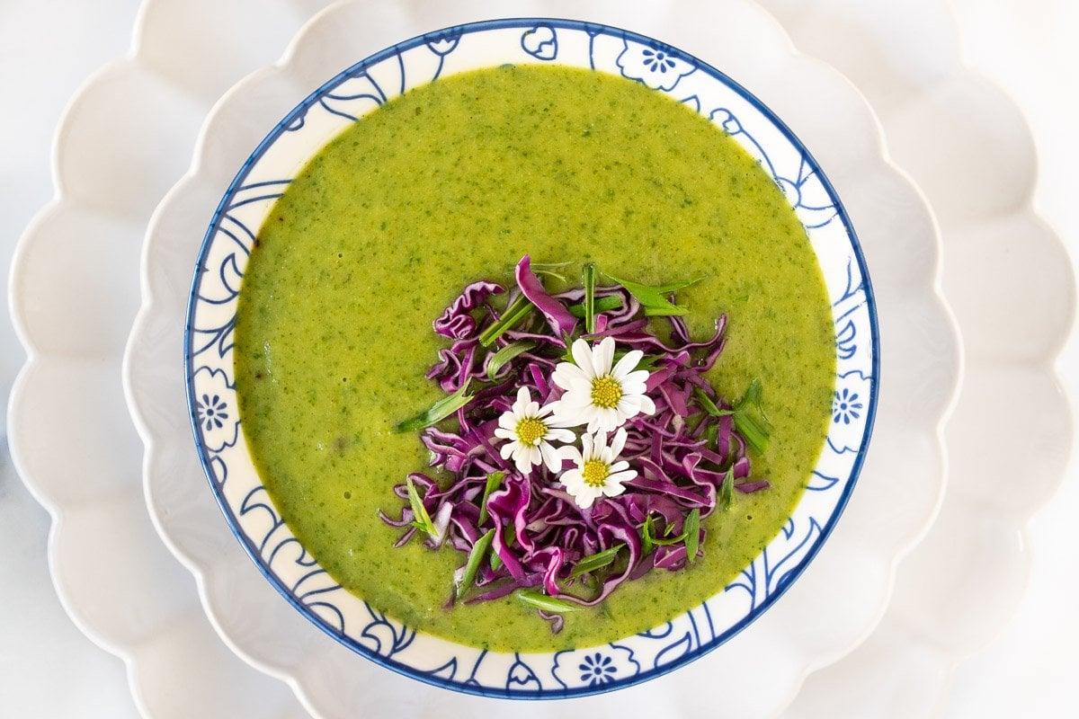 Overhead horizontal closeup photo of a bowl of Thai Broccoli Spinach Soup.