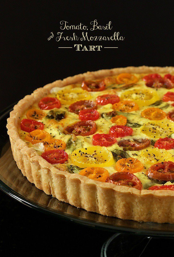 Tomato, Basil and Fresh Mozzarella Tart - with a super easy press-in crust, glistening jewel-hued tomatoes and lots of fresh basil, this tart makes a beautiful breakfast, lunch or dinner! www.thecafesucrefarine.com