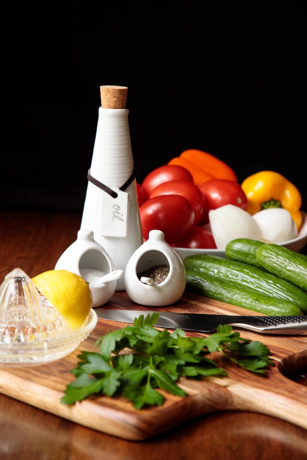 Photo of the ingredients used in the making of a Turkish Tomato Cucumber Salad.
