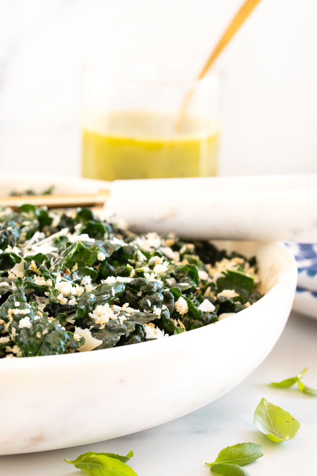 Vertical picture of Tuscan Kale Salad in a white bowl