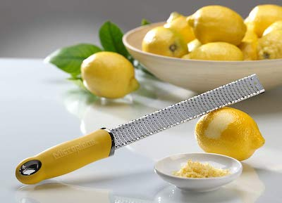 Stock photo of a yellow Microplane zester.