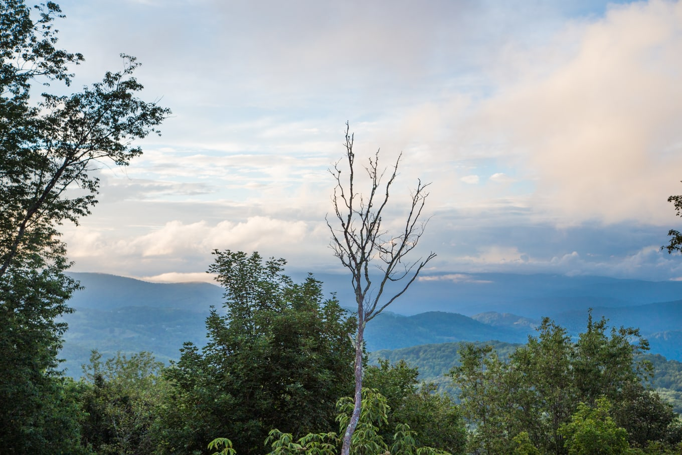 Panoramic shot of the North Carolina mountains with rain clouds in the distance.