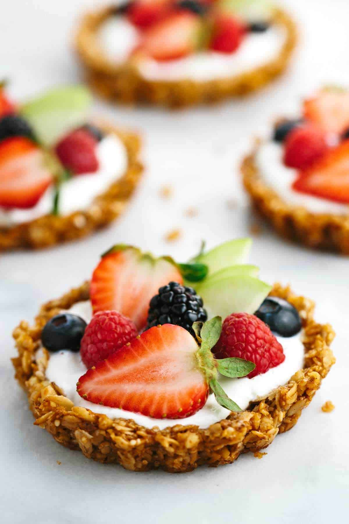 Closeup photo of Breakfast Granola Fruit Tart on a white background.