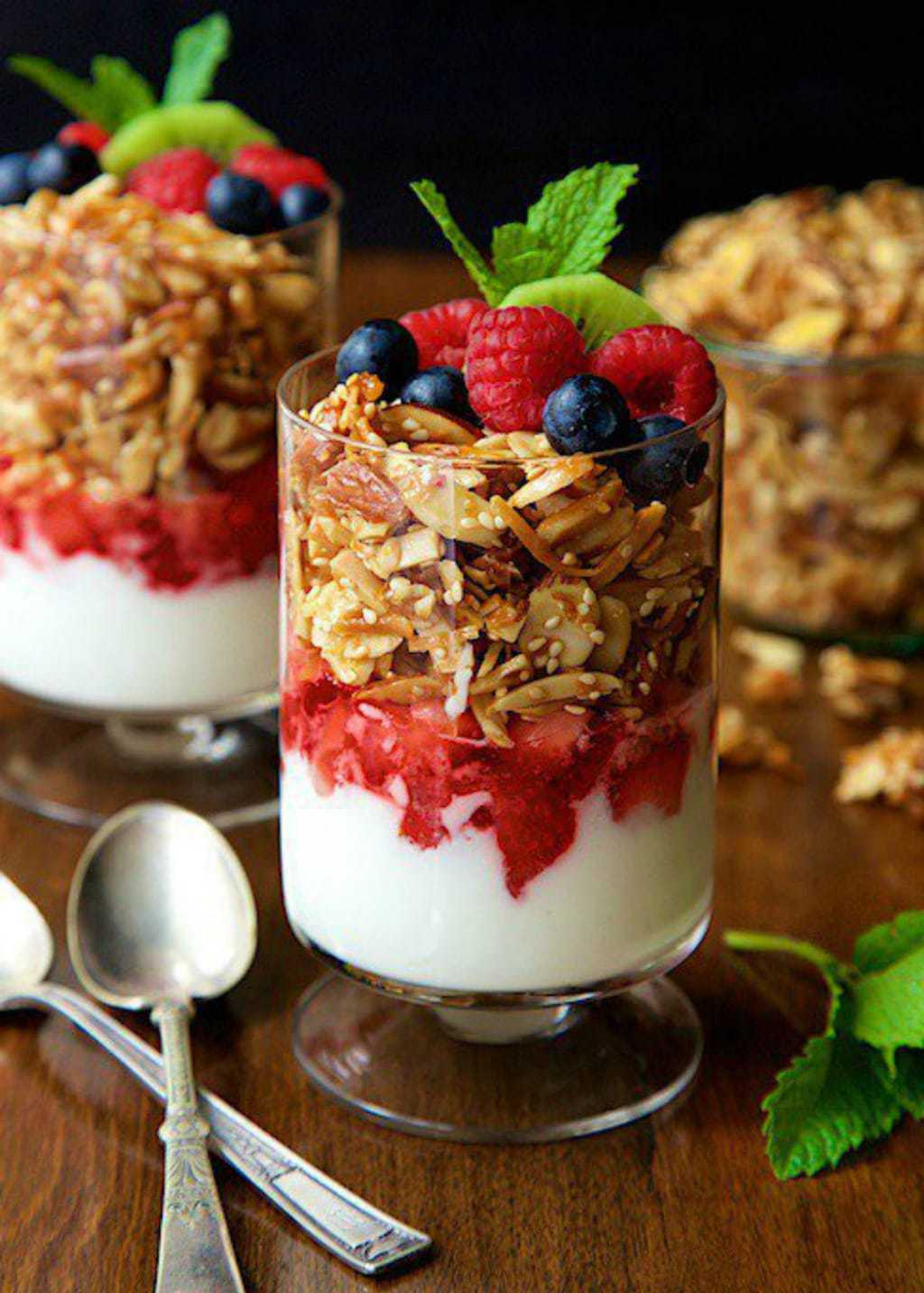 Photo of a parfait made with Double Almond Paleo Granola, fresh berries and yogurt.