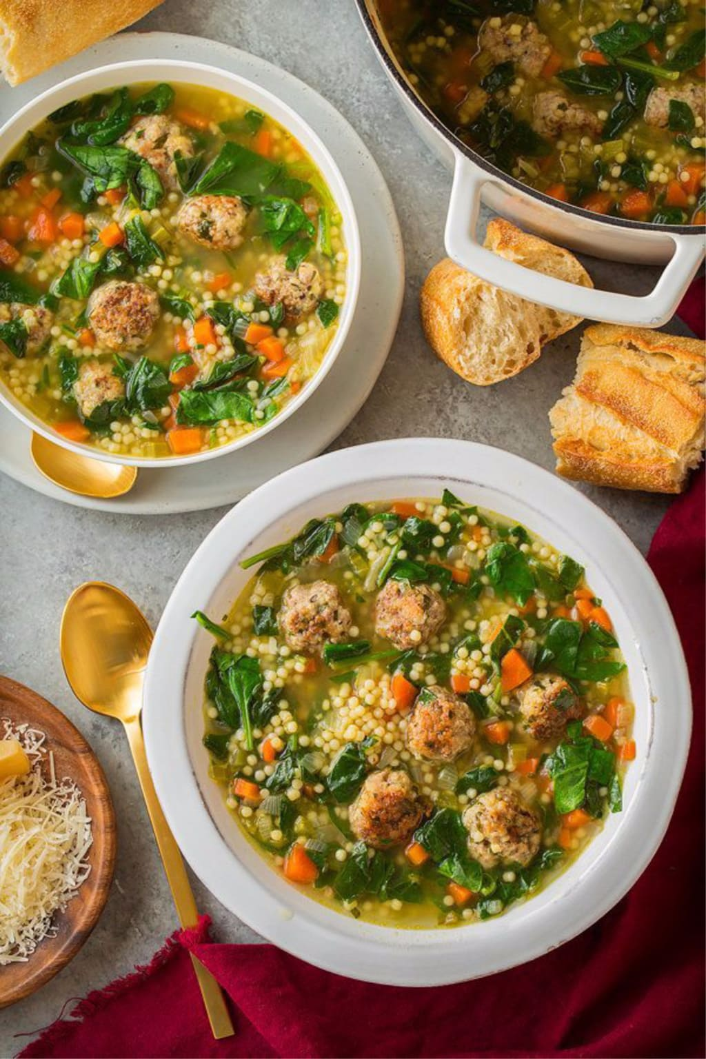 Overhead picture of Italian Wedding Soup in white bowls with bread
