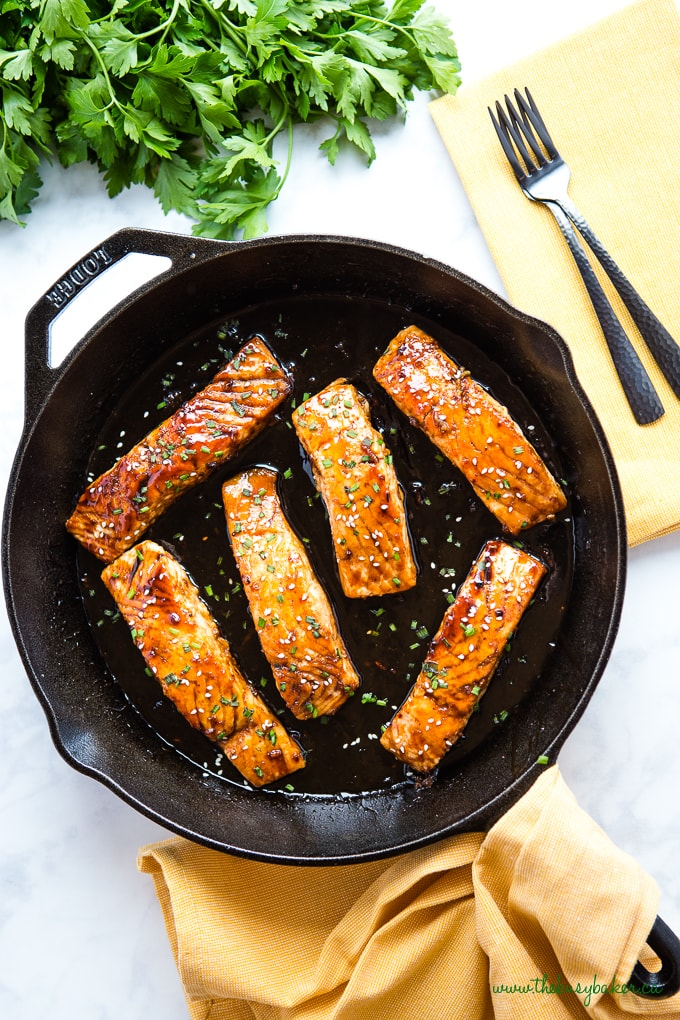 Overhead photo of Maple Glazed Salmon in a cast iron skillet from The Busy Baker food blog.
