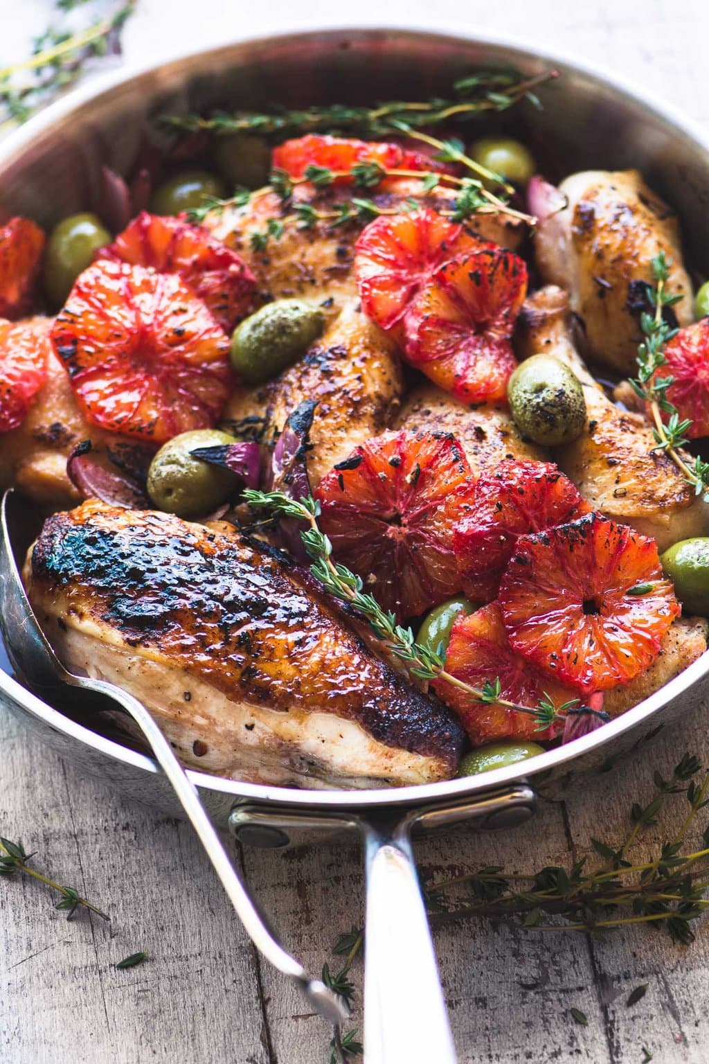 Overhead picture of Roast Chicken with Blood Orange and Olives in a skillet