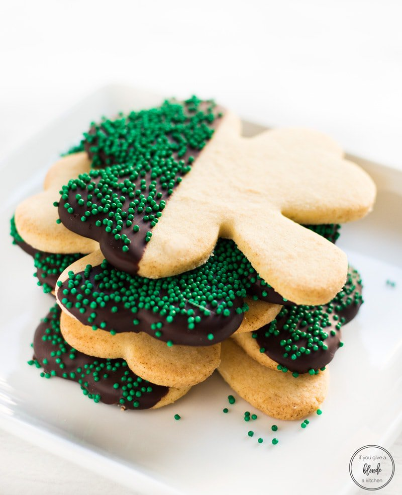 Photo of Shamrock St Patrick's Day Cookies in a stack on a white background from If You Give a Blonde a Kitchen food blog.