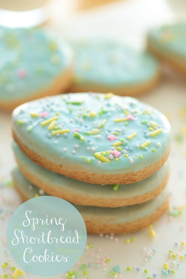 These delicious Spring Shortbread Cookies are crisp, buttery and have a simple decorating technique that's fun to do with kids! #easterdessert #easter #eastercookies #easy #easydecorating #shortbread #glazedcookies